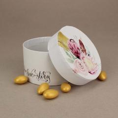 Μπομπονιέρα γάμου στρογγυλό χάρτινο κουτάκι με φλοράλ σχέδια